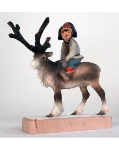 Sami Child Riding a Reindeer Carving